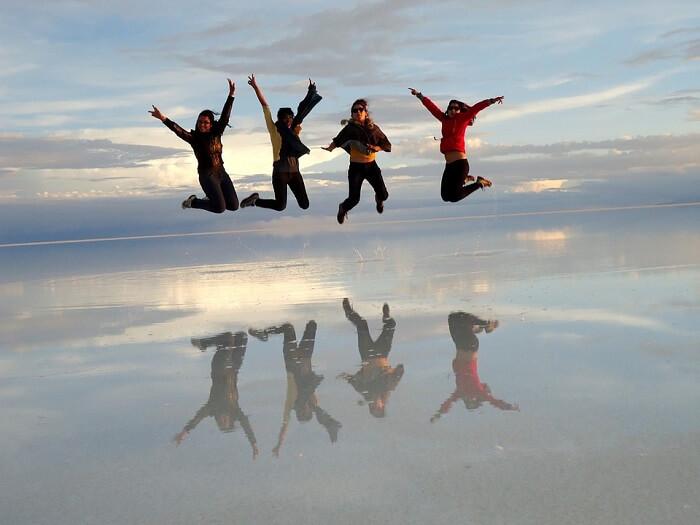 four friends jumping in the salt dessert